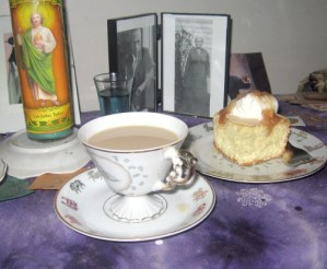 Offering of sponge cake and coffee to Aunt Caroline Dye