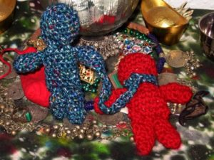 A pair of doll babies for a domination spell